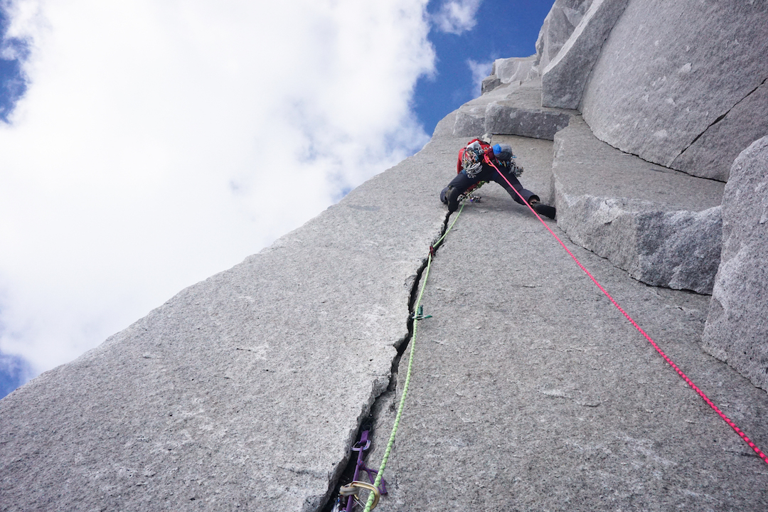 Drew Thayer follows a perfect splitter on the Dog Tooth, pitch four of Red Dihedral.