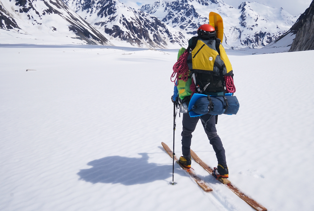 The climbers left base camp saddled with 110-pound loads, setting off toward the distant ocean. Fortunately, their handmade wooden skis held together for 15 miles of glacier travel.