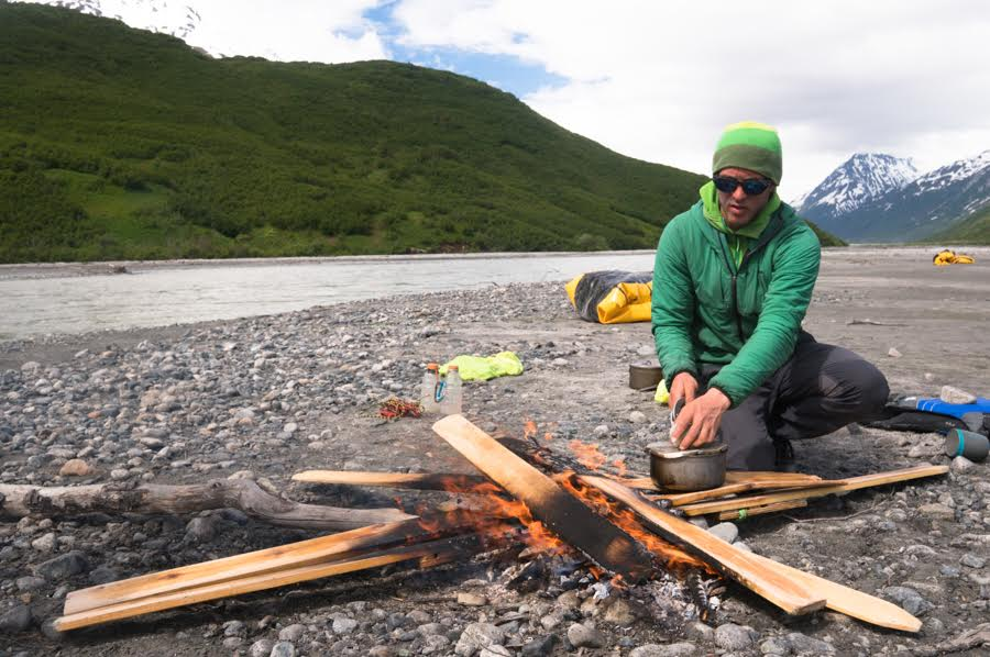 """""""It was hard to part with our homemade skis after three weeks of glacier travel, but they would become a hefty burden in the thick alder forests that we knew were coming. David Fay cooks our last dehydrated mushrooms on our farewell fire."""""""