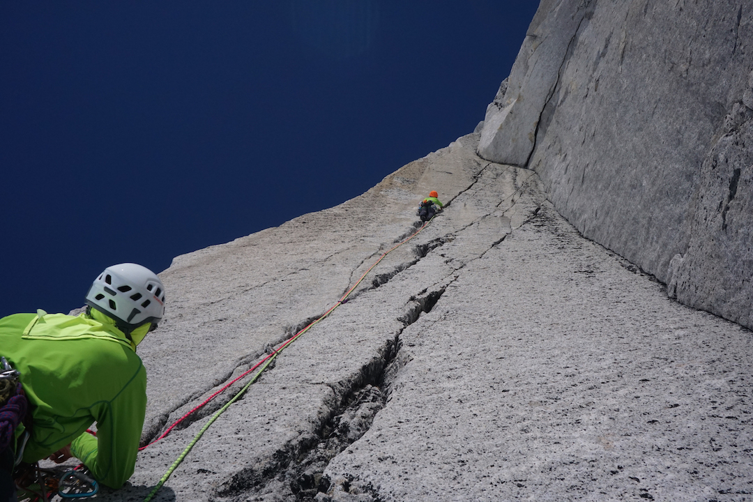 Craig Muderlak climbing a splitter hand crack on the second pitch of Red Dihedral on the Dog Tooth.