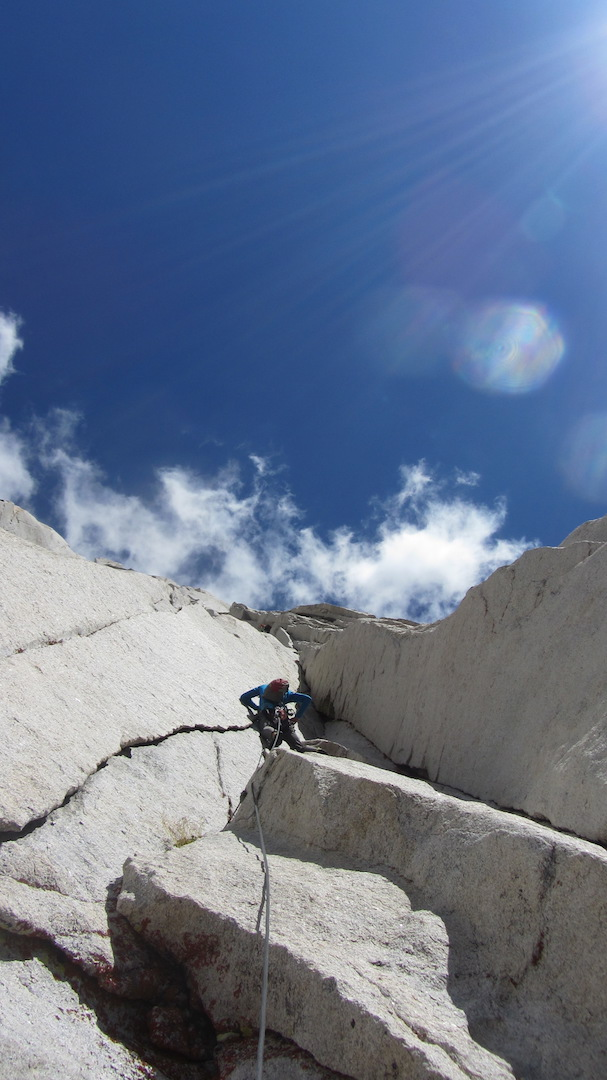 Aaron Cassebeer following the splitter undercling of pitch six on the first ascent of Lenticular Gyrations.