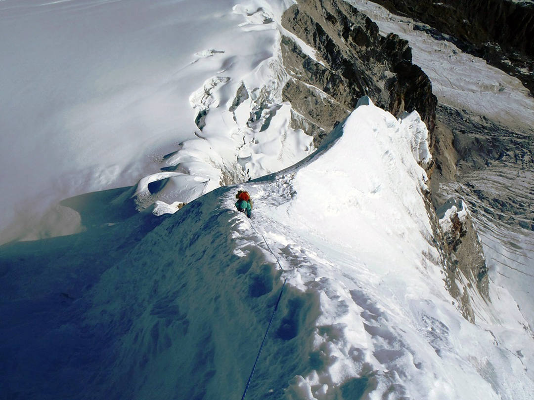 Kei Taniguchi climbing above the bivouac site on the fourth day of the attempt on Pandra's east face. The upper Chabuk Glacier is visible below left.