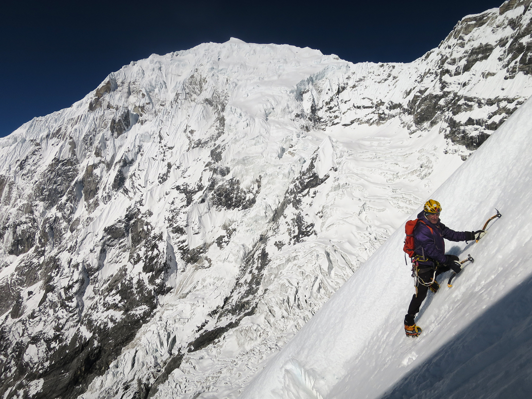 Giampaolo Corona during the initial foray onto the southwest face of Kimshung, with the east face of Langtang Lirung (7,234m) behind.