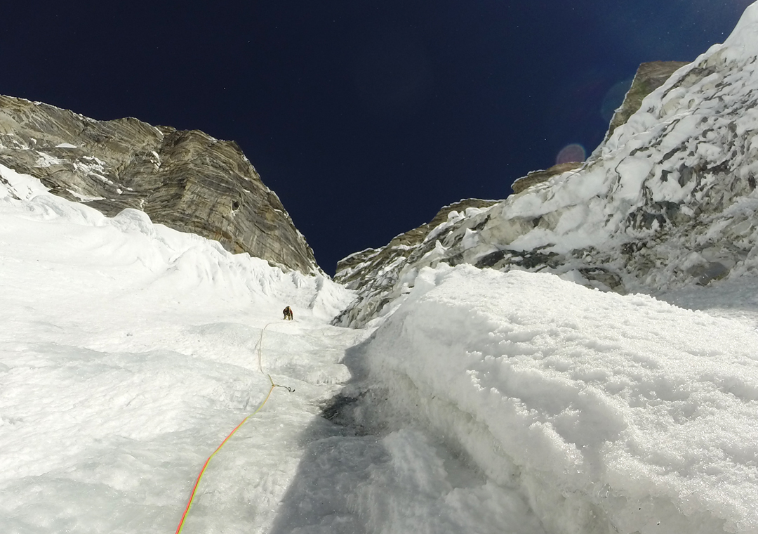 François Cazzanelli nearing the top of the long couloir on the southwest face of Kimshung.