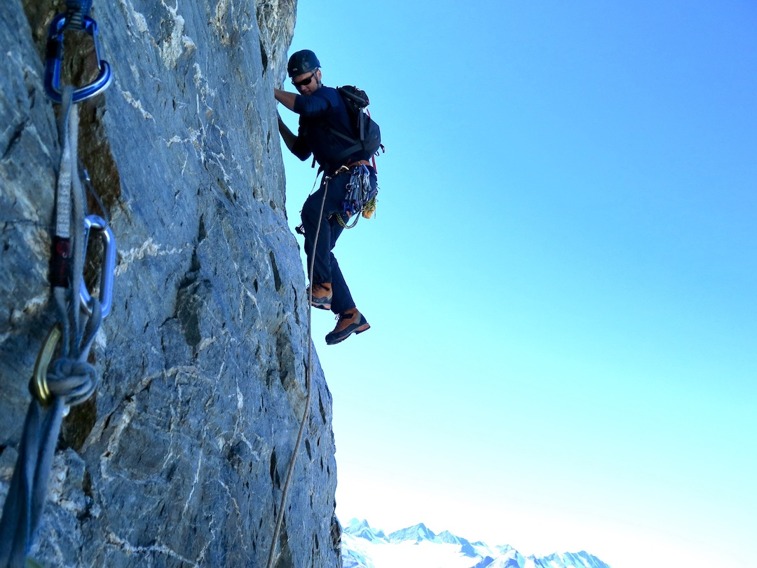 Ryan Sims climbing Center Line (1,000' of climbing, III 5.5 AI2) on the Cracked Ice Spire.