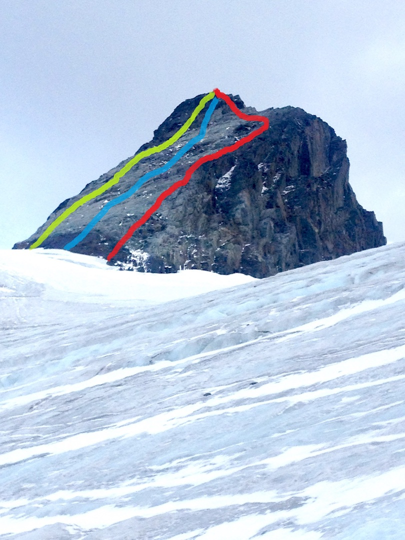 Cracked Ice Spire, showing the three routes completed by Taylor Brown and partners in 2016. Yellow: Canadian Kitten (5.6). Blue: Center Line (5.5). Red: Northwest Ridge (5.5).
