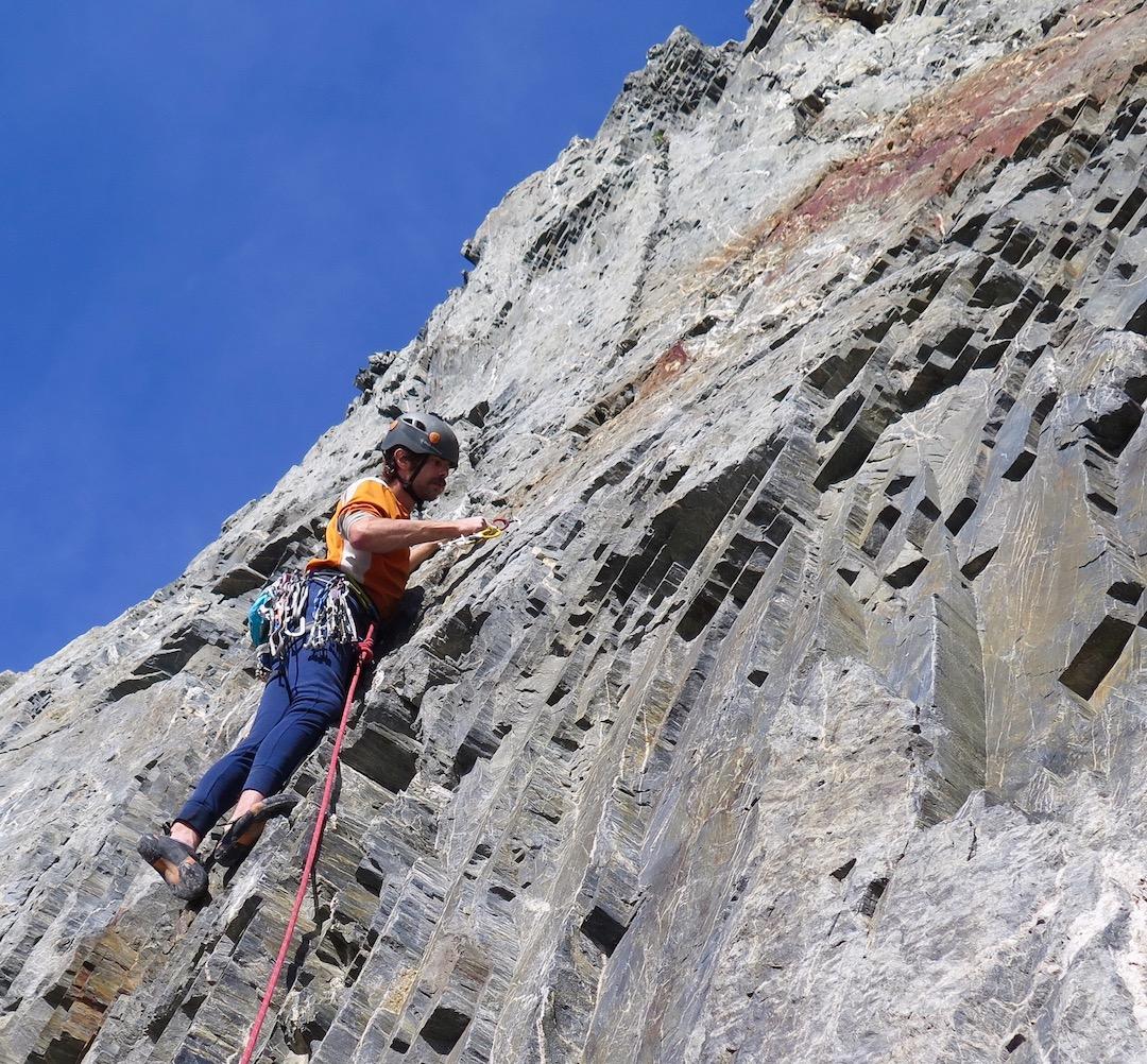 Daniel Linnel enjoying the sunshine and long-undies temps on the first ascent of Jujimufu (1,000' of climbing, III 5.9 AI2) on Graywacke Tower.