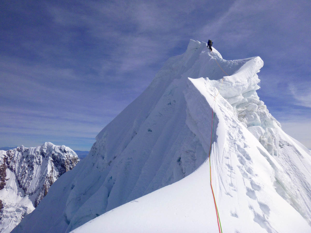 Looking north to Nathan Heald as he leads the final portion of the ridge to the summit of Jatunhuma.