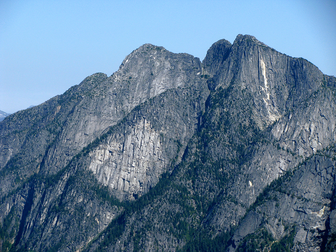 The Chinese Puzzle wall, below North Illusion Peak (left) and South Illusion Peak, photographed from near Pocket Peak, south of Slesse Mountain.