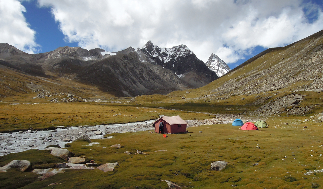 Base camp in the Pagolam Valley with Pogolha/Jang Tsang Go (6,328m) in the background.