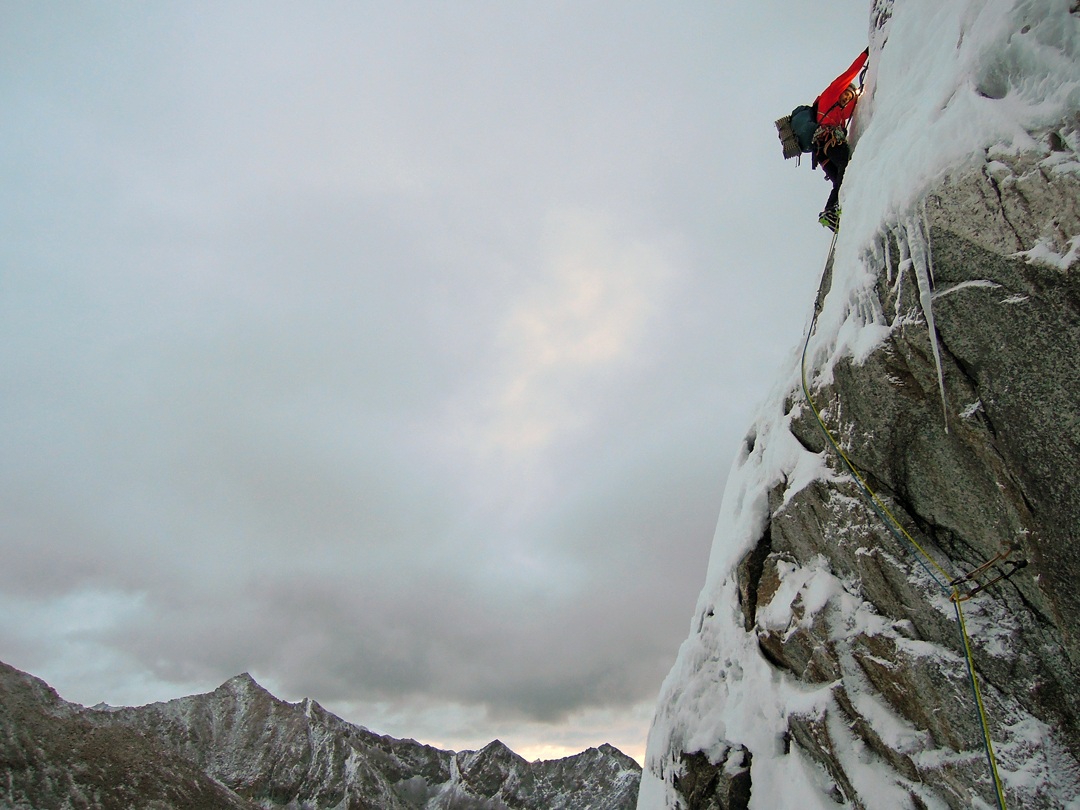 Olov Isaksson on steep mixed ground on the initial part of the northeast face of Pogolha/Jang Tsang Go (6,328m).
