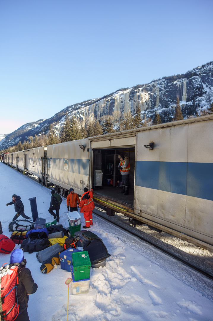 Unloading the train at mile-marker 51 with the cliff looming behind.