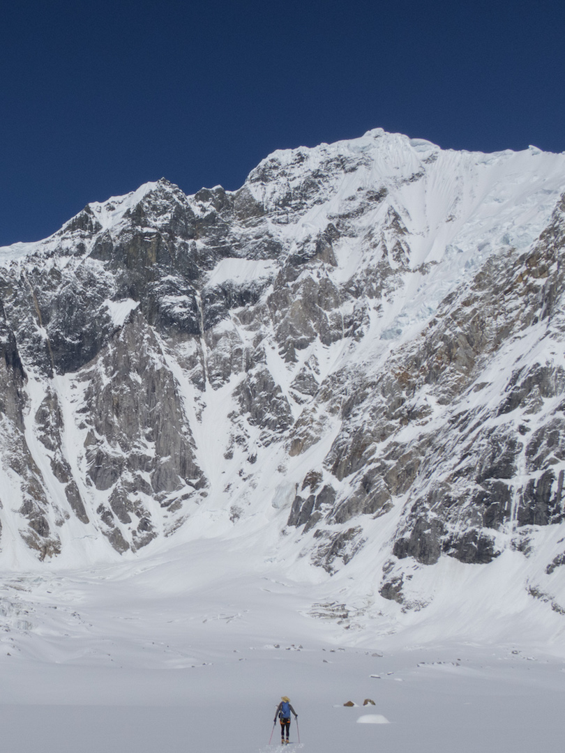Chris Wright scoping the west face of Celeno from the safety of base camp.