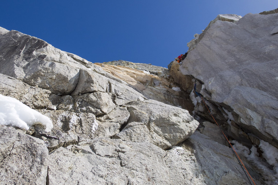 Graham Zimmerman tackling a steep mixed pitch on day one of the west face of Celeno.