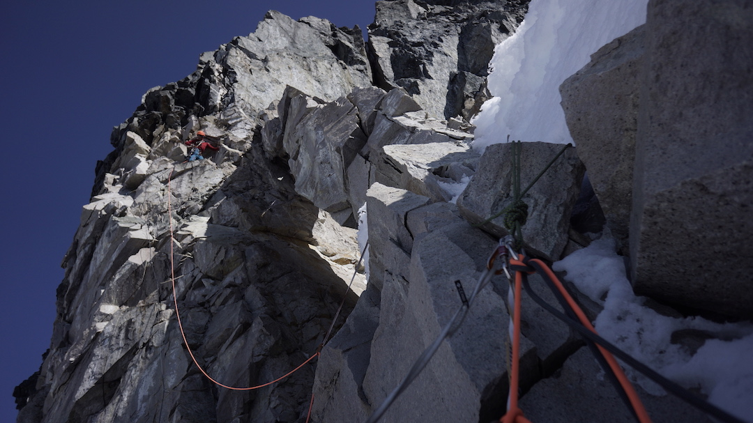 Graham Zimmerman following a traverse to reach the base of the crux rock section on the west face of Celeno.