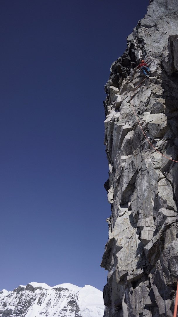 Chris Wright on the crux rock pitch of the west face of Celeno. This lead took more than three hours and went at 5.10 X A2+.