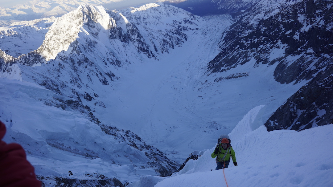 Chris Wright climbing on the upper west face of Celeno during day three.