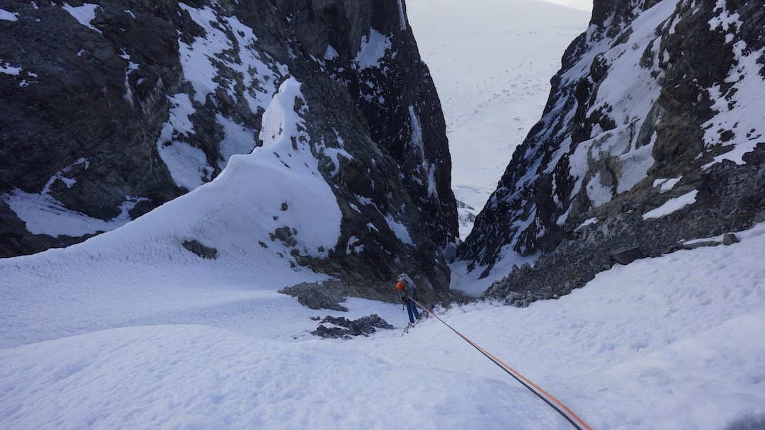 Chris Wright rappelling into the couloir that led down to the Canyon Creek Glacier during the descent from Celeno. The peak's first ascent, in 2012, began via this couloir.