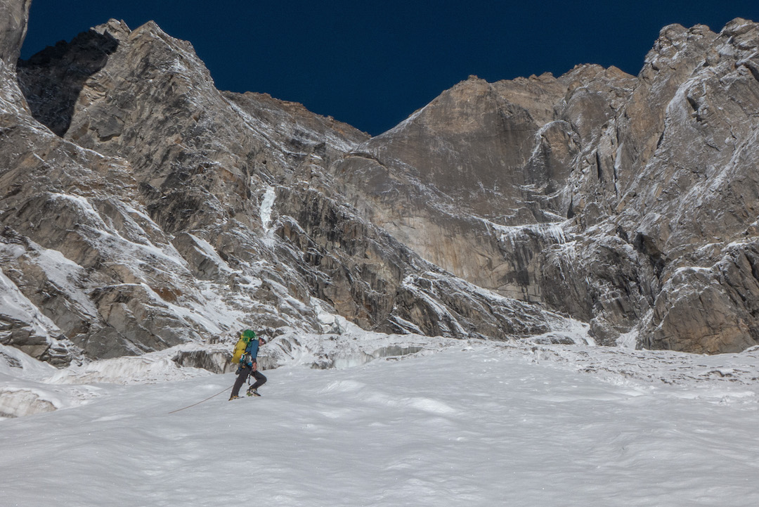 Approaching the awe-inspiring east face of Cerro Kishtwar. Near the foot of the 1,200-meter wall the team vacillated, wondering whether to try an easier-looking line to the left, but eventually they forged directly up the rock wall.