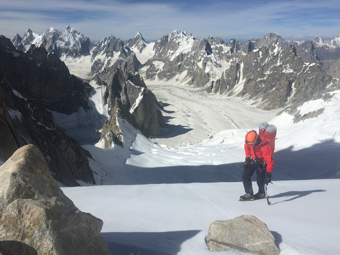 Steve Swenson arrives at the Polish Col, with the Lachit Glacier behind.