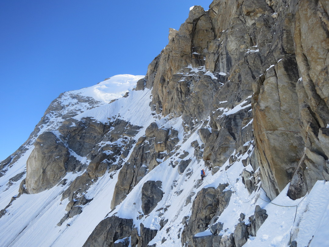 Graham Zimmerman midway across the key traverse on K6 West's southwest buttress.