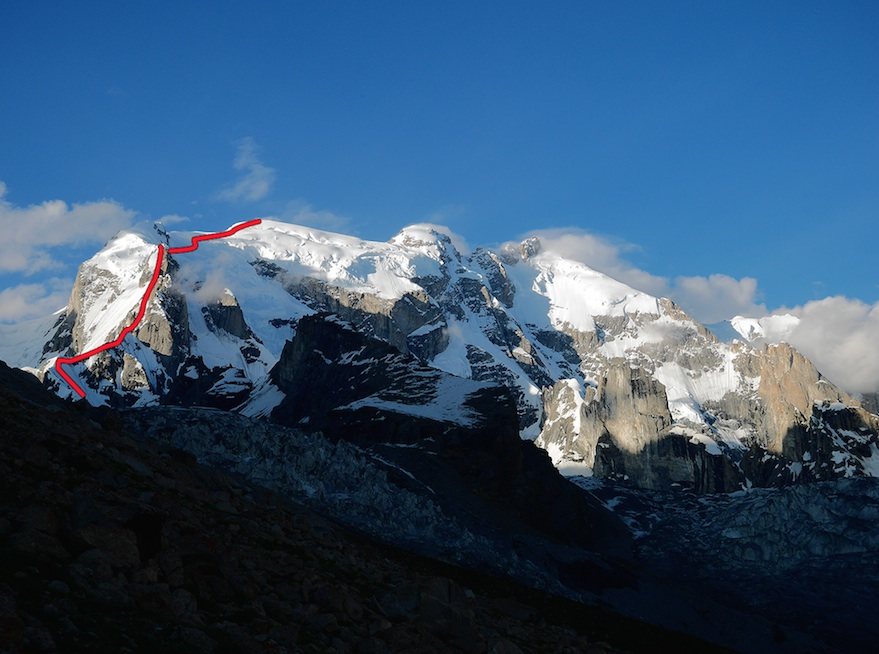 The K6 massif from the south, showing the new route up the southwest buttress of K6 West (7,040 meters), with the unclimbed central peak in the middle. In 1969, an Italian team reached ca 6,900 meters on K6 West by the snow and ice ramps right of the buttress.