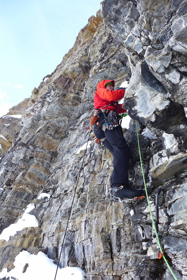Marc-André Leclerc begins a difficult mixed lead on Mt. Tuzo, with an ice tool as his first piece of protection.