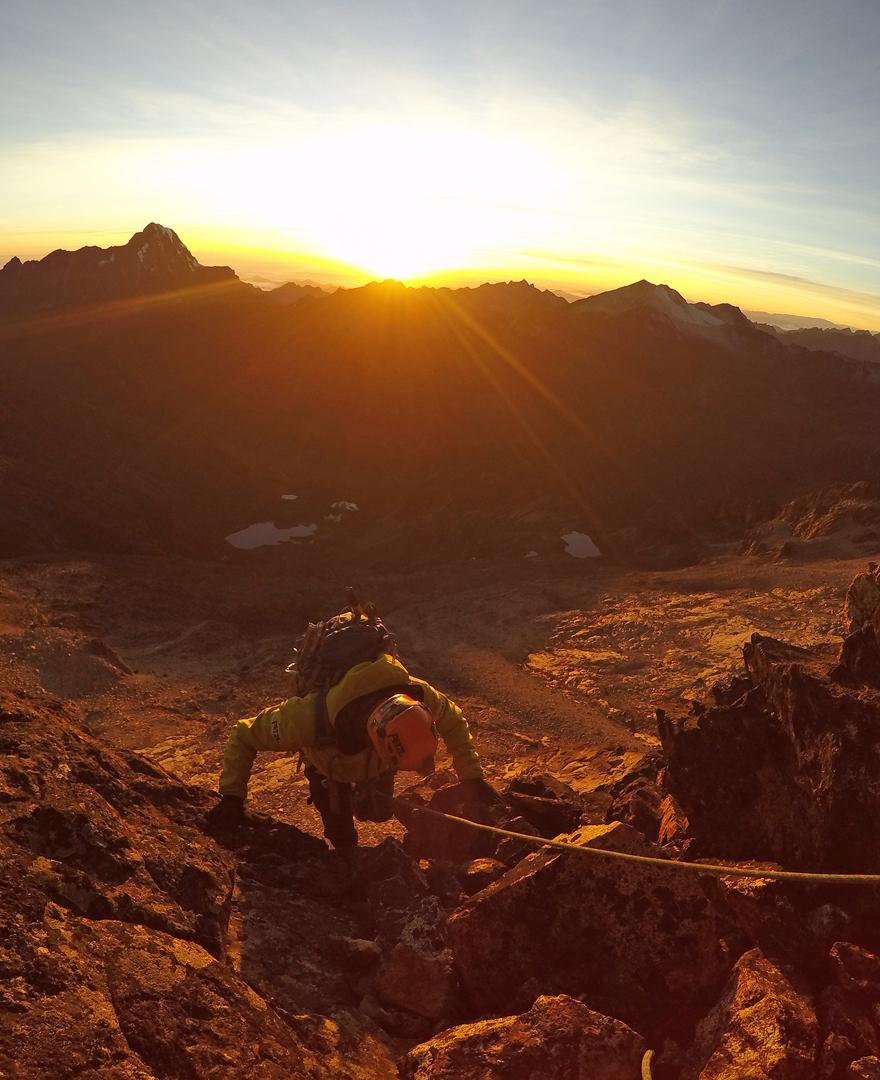 Juvenal Condori climbing on the north ridge of Pico Mesili (Aspirante 2016) as the sun rises.