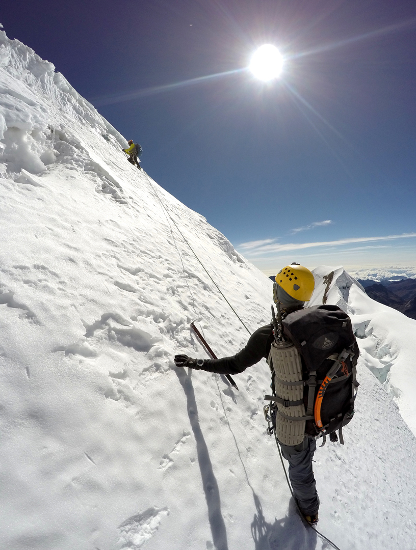 Juvenal Condori and Carlos Pineda about to cross a bergschrund before joining the northeast ridge of Huayna Potosi.