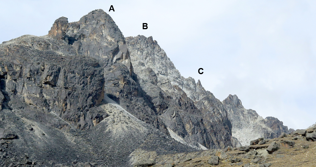 The Khala Cruz massif, as seen from the road one kilometer before it reaches the Zongo Pass. (A) Western buttress, climbed by the routes Condores y Picoflores, Muesca, 4 Estaciones, and El Techito de la Granja. (B) Main summit. (C) Eastern buttress. Patagonia Sunset climbs to this point then follows the skyline ridge back left to the main summit.
