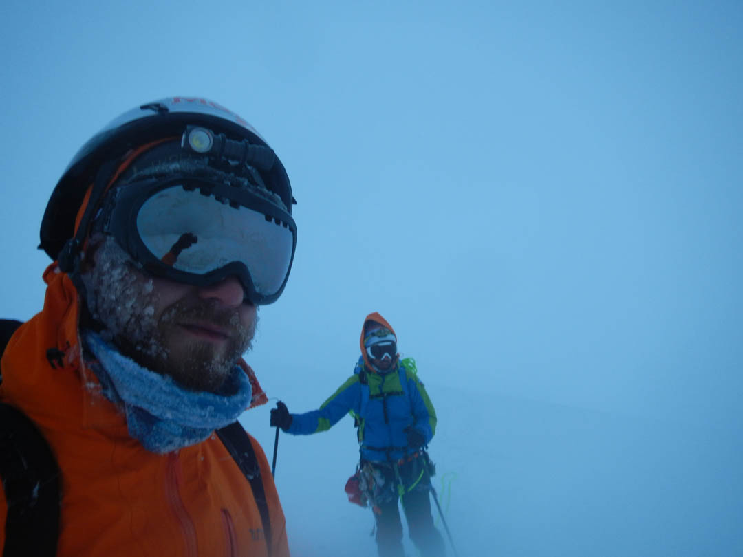 Ibai Rico and Evan Miles, still in a whiteout near the end of the hellish traverse.
