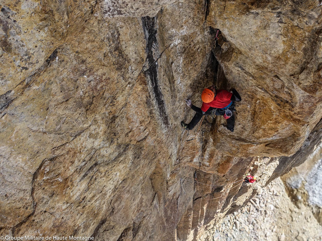 Dimitry Munoz leading a 7b pitch up a dihedral and wide crack on El Juego Sumando.