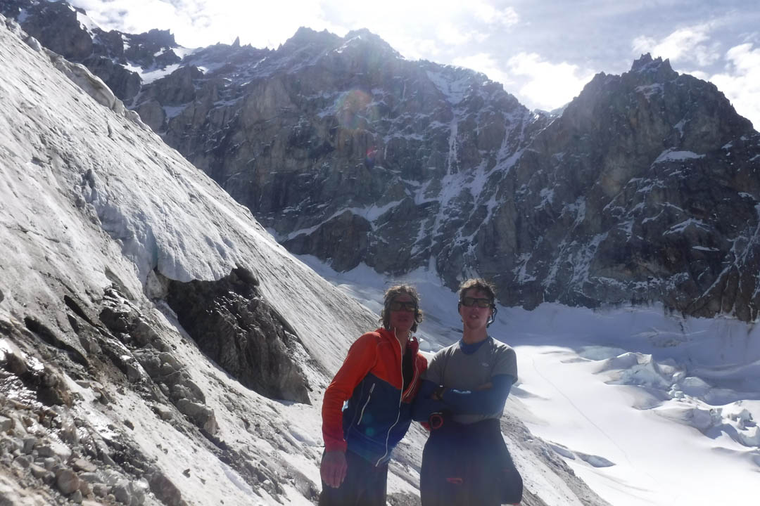 The Franchini brothers standing directly below their route on Cerro Penitentes' southeast face.