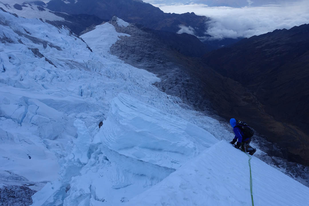 Nathan Heald prepares to cross a crevasse on the west ridge of Pumasillo.