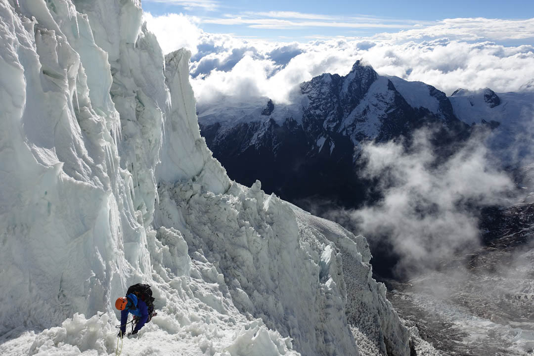 Nathan Heald downclimbing the west ridge of Pumasillo, with Choquetecarpo (5,500m) in the background.