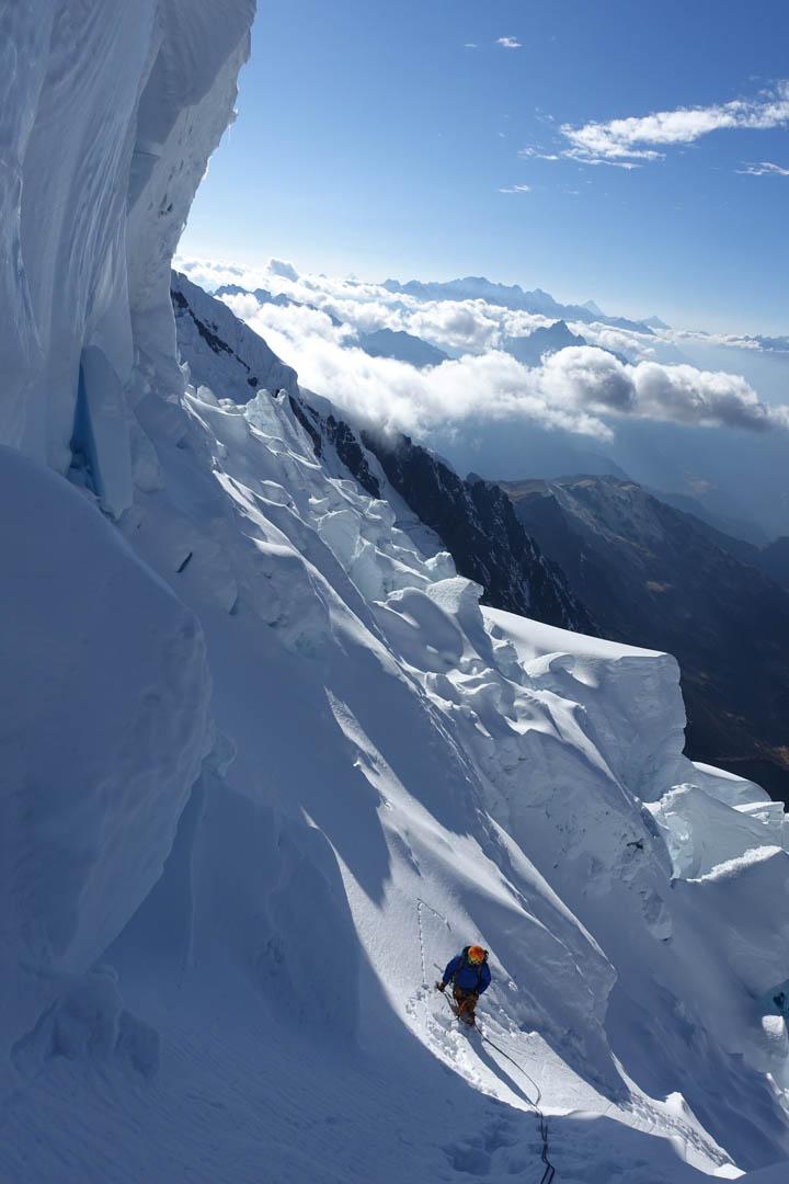 Duncan McDaniel climbing below a serac on Nevado Panta.
