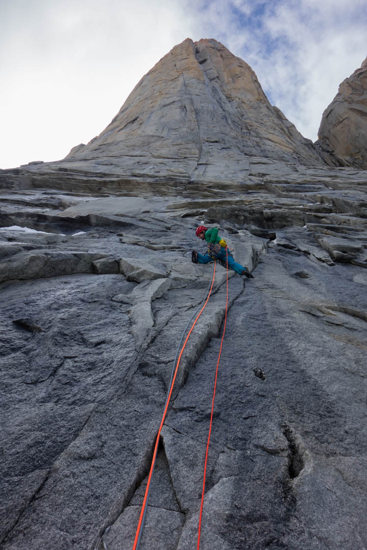 Nicolas Favresse leading up the lower slabs of El Regalo de Mwom,  with the obvious crack system above.