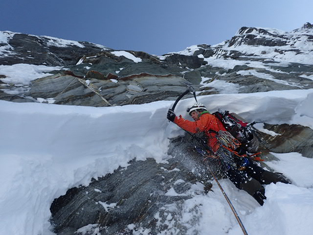Lukas Kirchner cleaning snow blocks above the bergschrund on the south face of Mt. Aspiring.