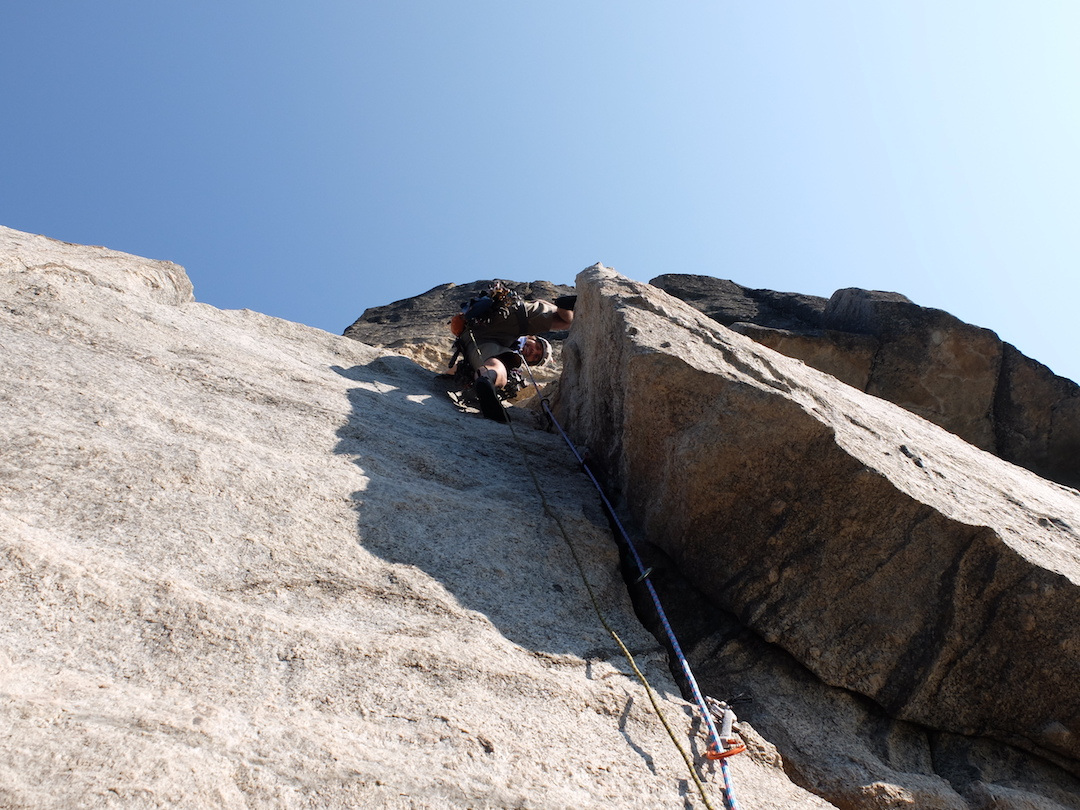 John Greer heading up the first pitch of Sierra Swashbuckle (IV 5.11 C1) on the Atlantis Wall above Donnell Reservoir. Supported by an AAC Live Your Dream Grant, Greer and Kuettner completed the wall's fifth reported route over a week in August 2016.