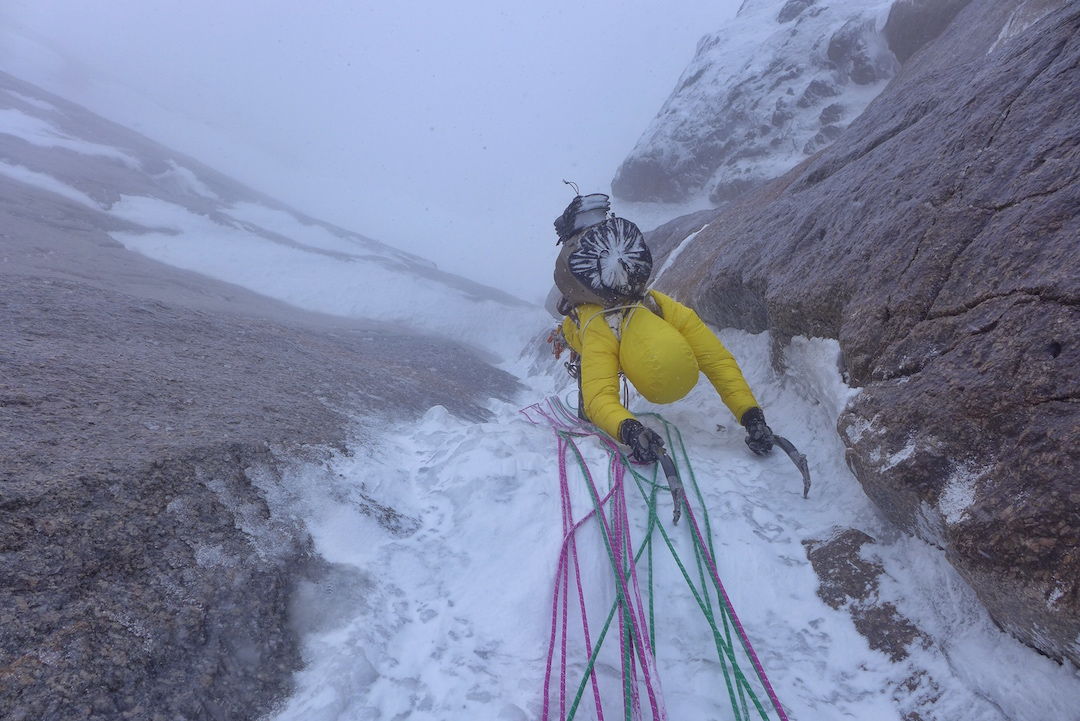 Ines Papert following a pitch in spindrift late on the first day of the first ascent of Lost in China on Kyzyl Asker.