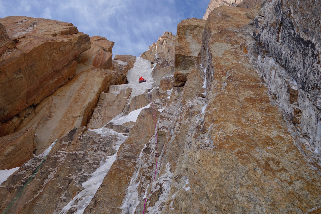 Luka Lindič leading dreamy ice through red granite on the first ascent of Lost in China.