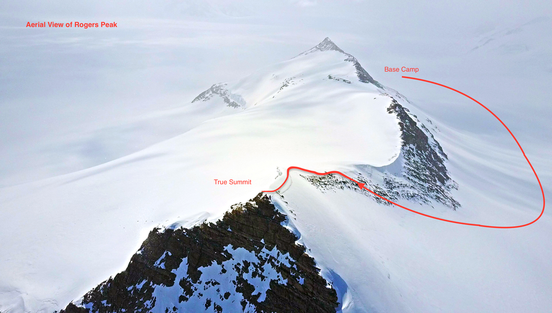 An aerial view looking north along the ridge of Rogers Peak (1,521m), with the route to the summit, passing the lower northern top, from the 2017 base camp.