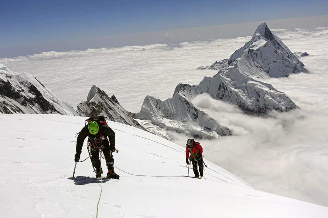 Choi Seok-mun and Park Joung-yong approaching the summit of Gangapurna. In the background is Machapuchare (also often spelled Machhapuchhare, 6,993m).