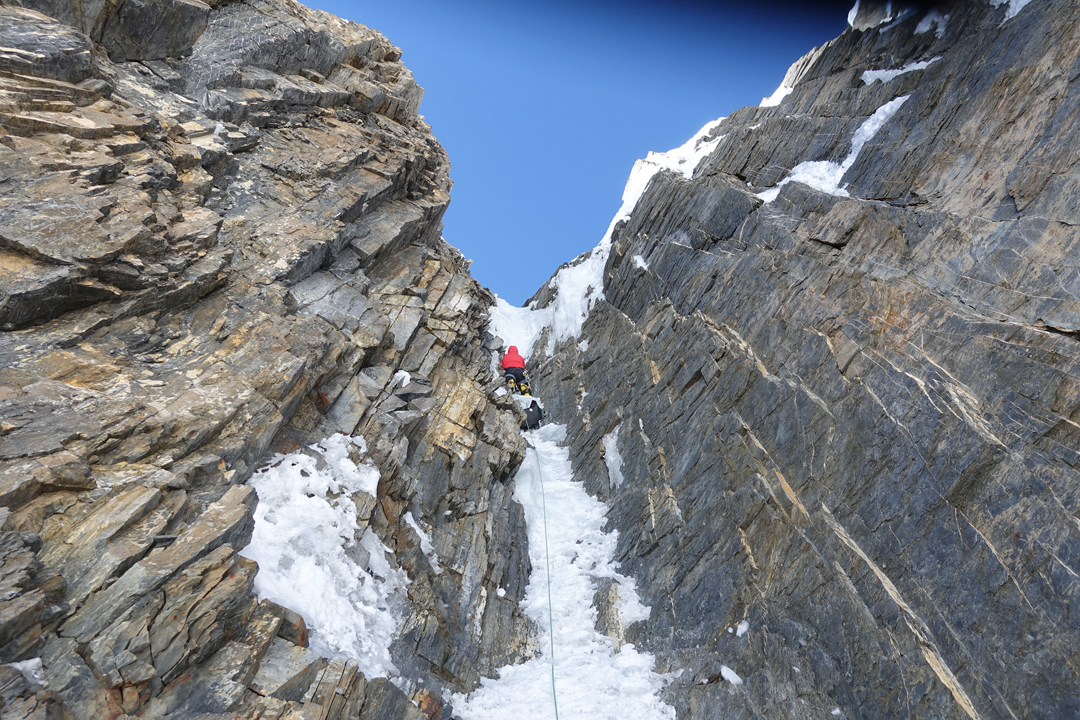 Kim Chang-ho climbing a section of vertical ice at 7,100m, near the top of the rock barrier on the south face of Gangapurna.