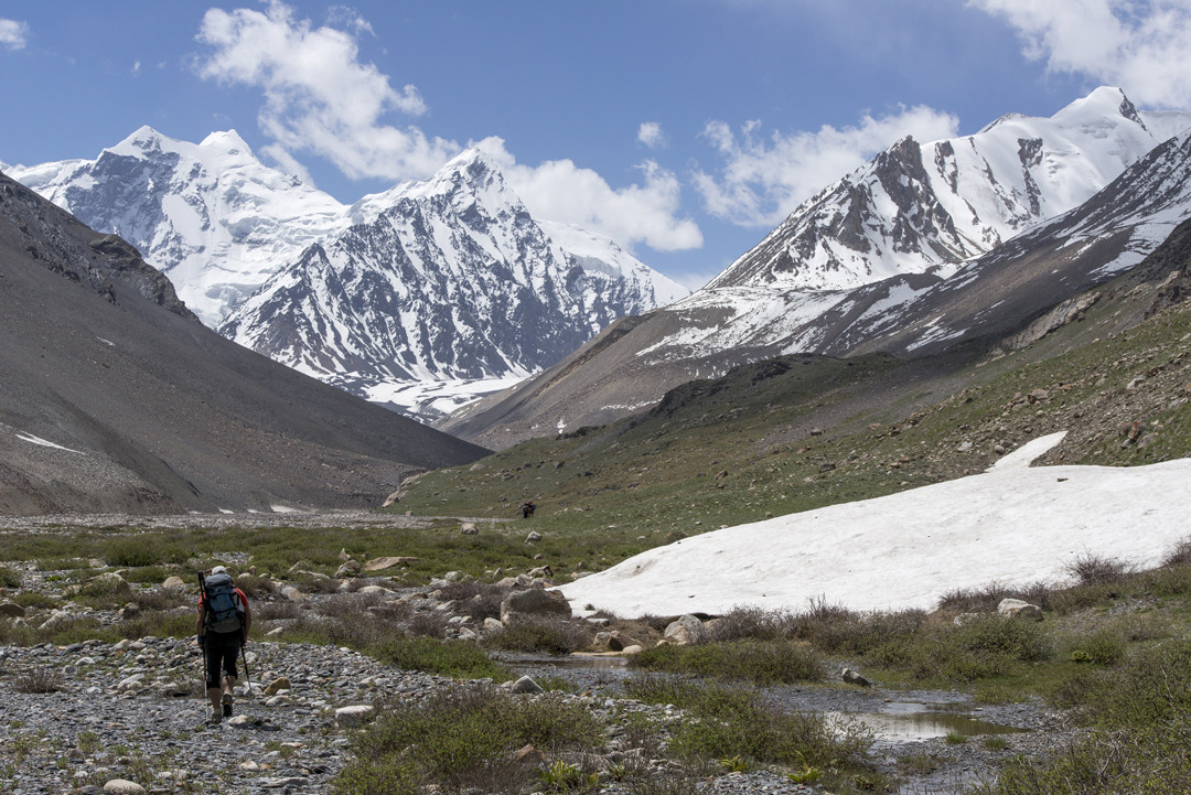 Walking up the Qara Jilga Valley. Greta Sar is the highest summit at the back (second peak from left). Koh-e-Wakhan is just beyond. In 2013 a British-South African team attempted the first summit from the left via the ridge that diagonals down to the left (northeast). They abandoned the attempt when one member was hit badly on the head by falling rock (AAJ 2014).