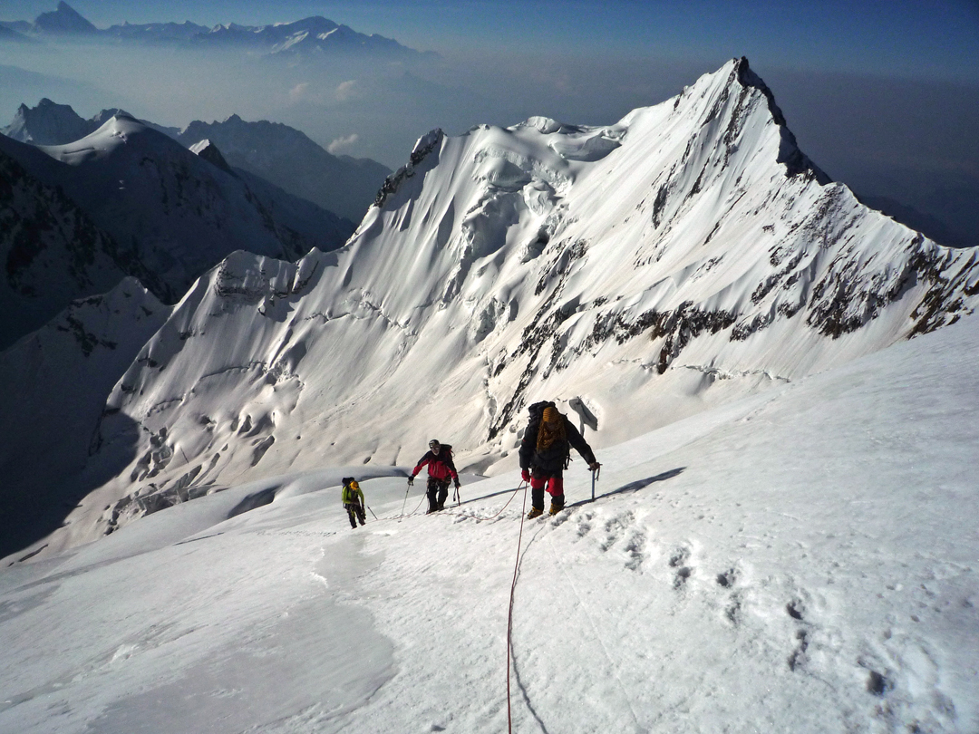 The final ascent up the south face of Vishnu Killa, with unclimbed Peak 5,880m behind.