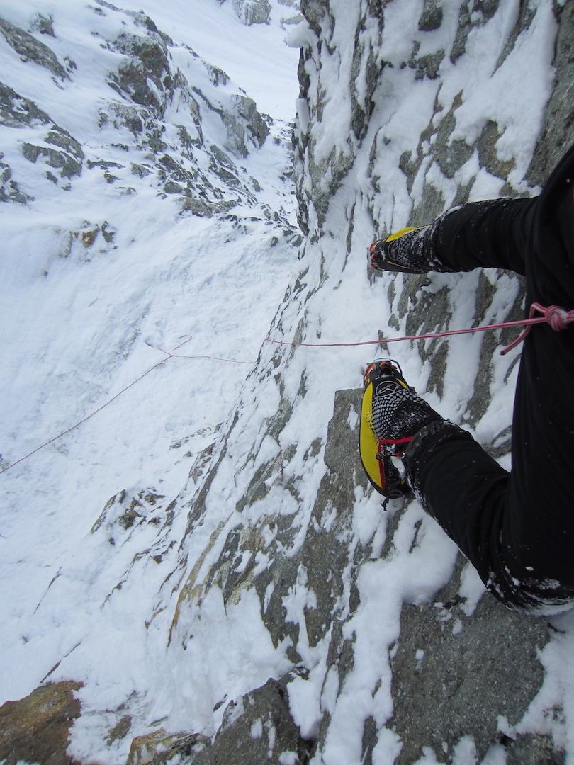 Looking back down while soloing through the first crux in the Black Band of the Infinite Spur on Mt. Foraker.