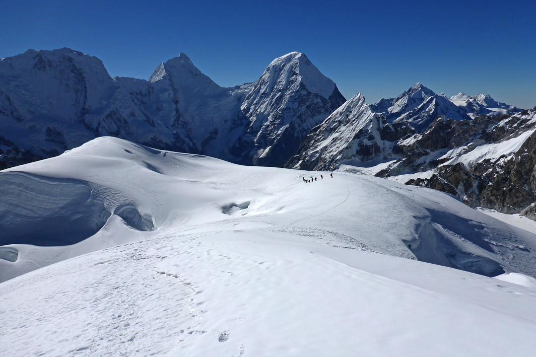 The final section of the southwest ridge of Karbu Ri (6,010m GPS), with members of the British expedition en route to the summit. The view is looking south toward the big peaks of (left to right) Peak 6,664m, Takargo (a.k.a. Thakar Go, 6,771m), and Chobutse (6,686m).