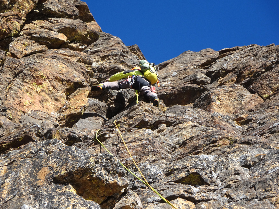 Climbing the lower rock buttress during the first day of the ascent of Peak 5's southwest pillar.