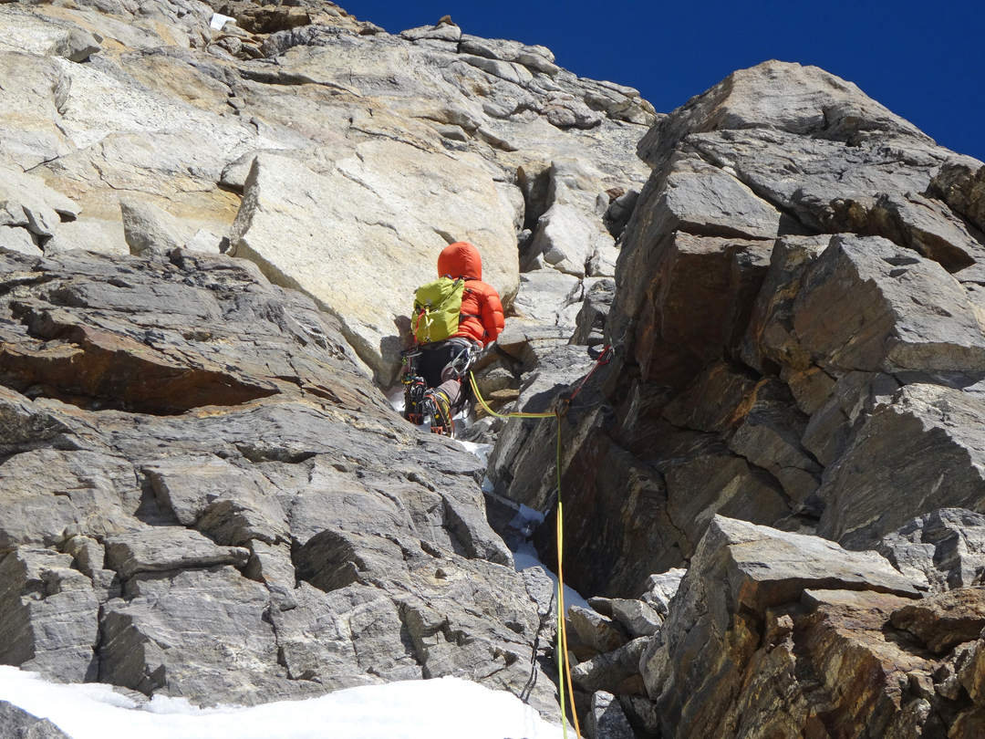 On the upper rock buttress during the second day of the ascent of Peak 5's southwest pillar.